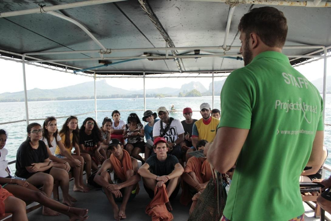 Diving volunteers are briefed by staff before a dive